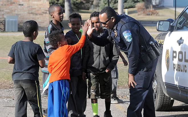 Officer Mohamed Mohamed enjoys stopping by impromptu soccer games while fulfilling his community policing duties in Mankato. He's hoping to start a more organized sports program this summer. Photo by Pat Christman